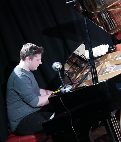Luke Gardner performs on piano