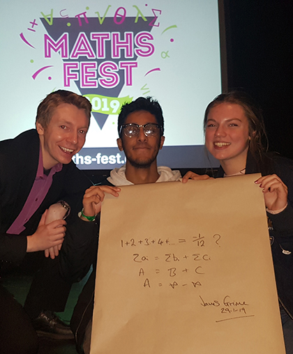 Maths students with James Grime